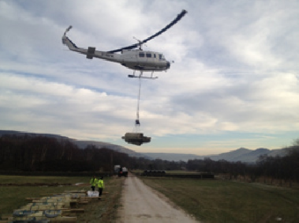 Helinorth Helicopter load lifting in remote location