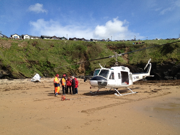 Helinorth Helicopter lifting a boat from beach