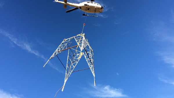 Helinorth Helicopter lifting pylon in galway